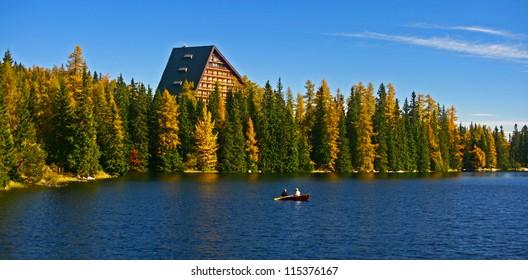 Rowing on tarn Strbske pleso in High Tatras mountains, Slovakia