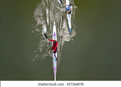 rowing race between man and woman. Gender equality