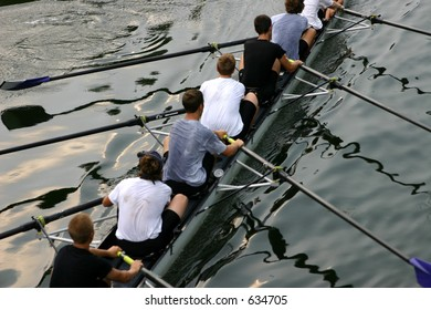 Rowing team on water