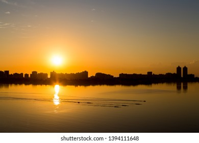 Rowing training under sunrise at Biscayne bay, Miami, Florida.