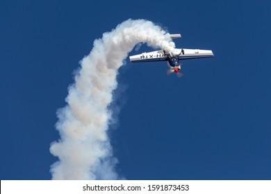 Rowland Flat, Australia - April 14, 2013:  Aerobatic pilot Paul Andronicou flying a single engine Extra 300S aerobatic aircraft VH-XTR.