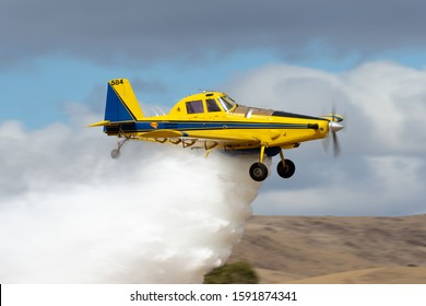 Rowland Flat, Australia - April 14, 2013: Air Tractor 802 agricultural and fire bombing aircraft VH-ODH dropping a load of water.