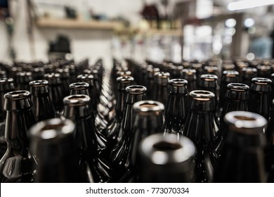 Rows of 500ml glass bottles prepared to beer filling and bottling on microbrewery.