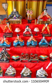 Rows of antique, handmade porcelain dolls dressed in colorful kimonos represent an ancient emperor, empress, and their court attendants during the Doll Festival ('Hinamatsuri') in Japan.