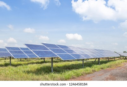 rows array of polycrystalline silicon solar cells or photovoltaic cells in solar power plant turn up skyward absorb the sunlight from the sun alternative renewable energy from the sun on blue sky