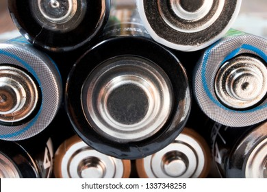 Rows of batteries stacked on top of each other. Up close macro shot.