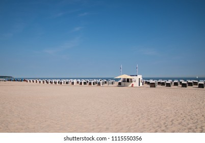 Rows of beach chair huts and a snack bar located on the beautiful white sand beaches of the northern Germany coastal city of Warnemunde before the tourists arrive on this date