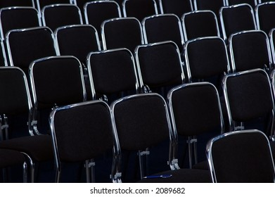 rows of black business chairs