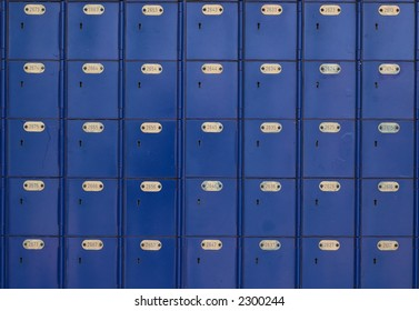 Rows of blue post office boxes with numbers