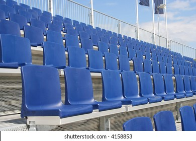 Rows of blue seats in a sports stadium