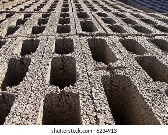 Rows of bricks stacked in a construction site