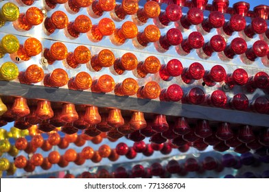 Rows of brightly colored carnival lights warm colored bulbs on silver