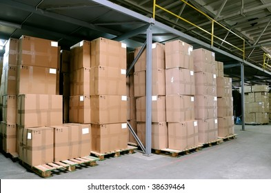 Rows of cardboard boxes in warehouse