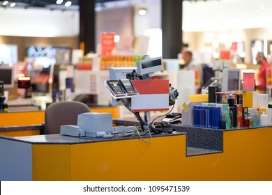 Rows of cash desks with cashiers and customers on blurry background