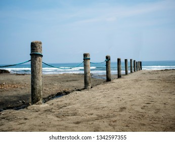 Rows of cement barrier or fence serves as a boundary or borderline of beach property.