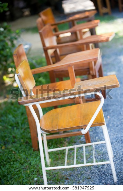 rows of a chairs. empty Steel Lecture chair with wood seat table squab with clipping path. The outing education concept.