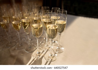 Rows of champagne glasses. Alcohol party, wedding celebration and other events