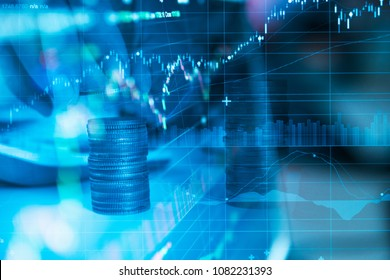 Rows of coin and graph of stock market trade indicator financial for investment strategy. - Shutterstock ID 1082231393