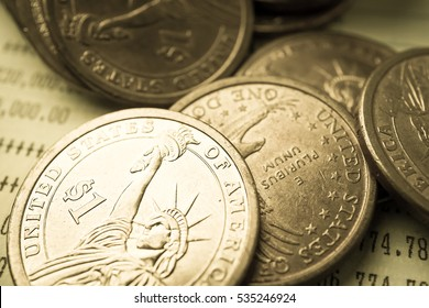 rows of coins and account for finance and business concept
