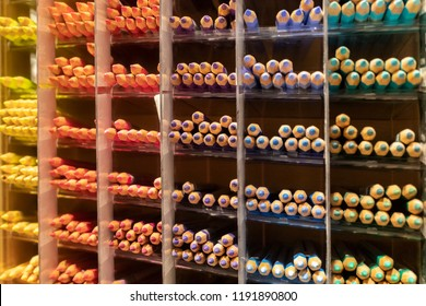 Rows of color pencil categorized in a shop