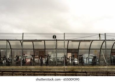 Rows of commuter bikes set against a cloudy overcast sky