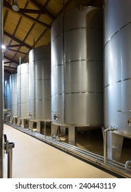 Rows of contemporary stell barrels in  factory