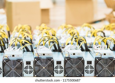 Rows of dedicated ASIC for cryptocurrency mining farm. Bitcoin, Ethereum and other altcoins producing rig.