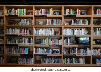 Rows of different colorful books lying on the shelves in the chiang mai Library 31 May 2019