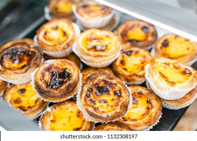 Rows of egg tart, traditional portuguese dessert, pasteis de nata, custard tarts. Cafe on the streets of Lisbon, Portugal