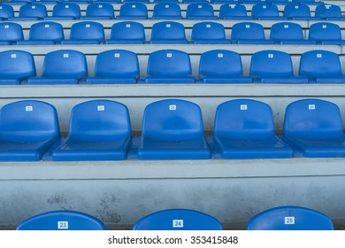 Rows of empty bleachers positioned in a semicircular pattern. Stadium seats before an event.