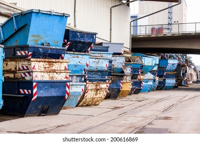 Rows of empty garbage tips stacked ready for use in collecting and disposing of household and industrial waste and rubbish in a depot or warehouse yard