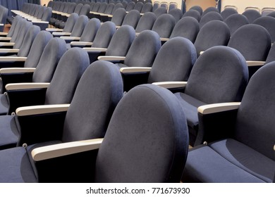The rows of empty gray seats in the auditorium, conference hall or theatre