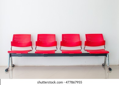 Rows of an empty red seats made from plastic