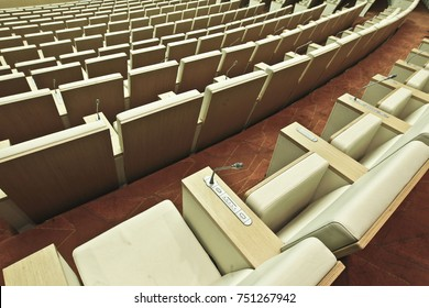 Rows of empty soft armchairs in the conference hall.