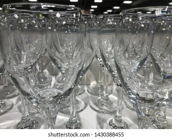 Rows of empty wine glasses on the showcase