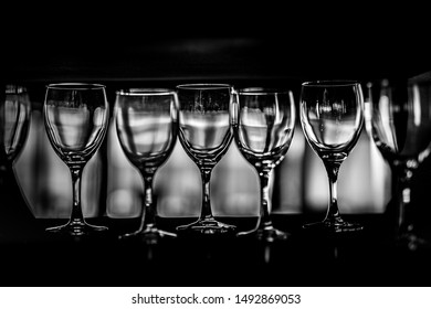 Rows of empty wine glasses on the showcase, black and white photography