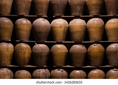 rows of fermented alcoholic beverage in the old pottery at Puli Brewery, Nantou, Taiwan
