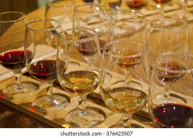 Rows of glasses with red and white wine