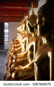 Rows of golden Buddha statue at  Wat Pho temple, Thailand
