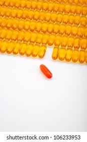 Rows of golden gel capsules