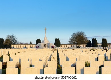 Rows of Gravestones at Tyne Cot World War One Cemetery, the largest British War cemetery in the world.  near Ypres, Flanders, Zonnebeke, Belgium. Photo taken at Sunset in the Golden Hour.