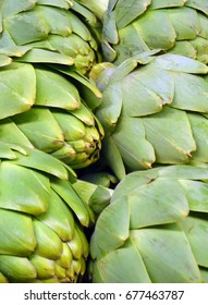 Rows of green artichokes at market