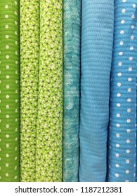 Rows of green and blue pattern fabrics