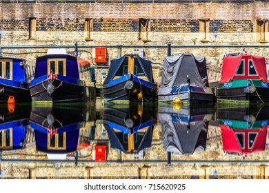 Rows of houseboats and narrow boats on the canal banks at St Pancras Yacht Basin, part of the Regent's Canal in London