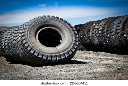 Rows of huge tyres used for large-scale mining vehicles. Queensland Australia