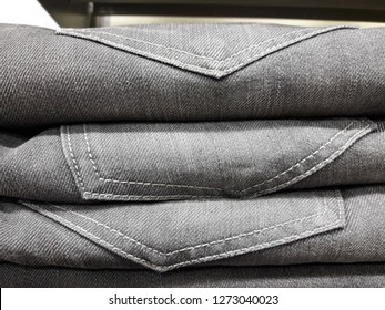 Rows of jeans  in a shopping mall