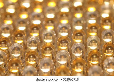 Rows of LED light bulbs in yellow and white, forming a pattern