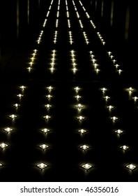 Rows of lights illuminating a floor or walkway