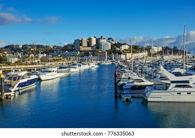 Rows of luxury boats along the English resort town of Torquay, South Devon