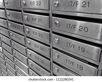 The rows of metal letterbox or mailbox at the residence for the letter, mail or message with black and white style filter.